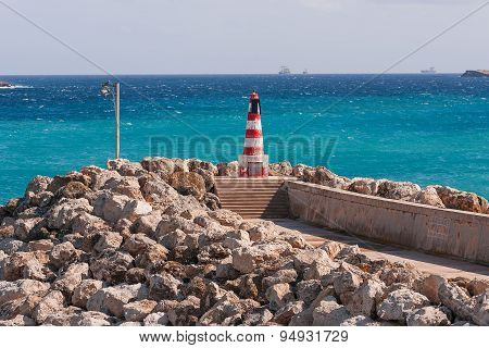 Entrance In Bay, Seafront With Lighthouse On Seafront. Gozo, Malta.