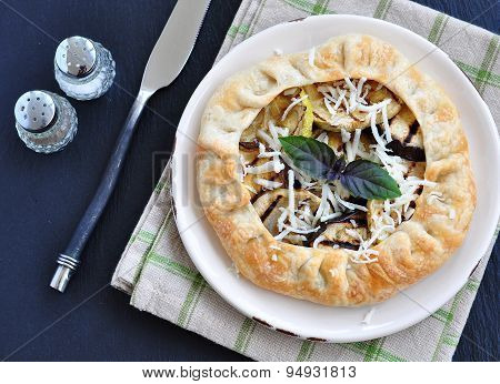 Galette pie with grilled vegetables and provolone cheese