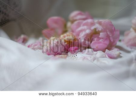 Bunch Of Peony Flowers On White Vintage Tablecloth. Selective Focus