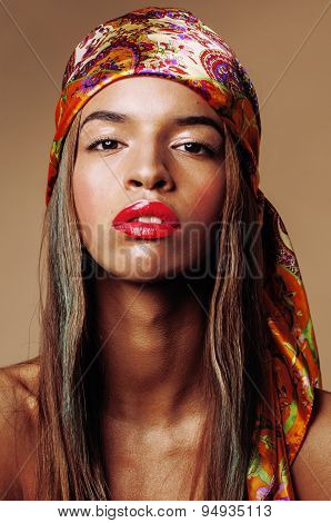 beauty young afro american woman in shawl on head smiling close