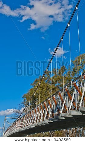 Suspension Bridge against a Blue Sky. Lots of room for text or logos
