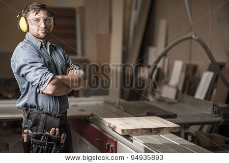 Mature Carpenter In The Workshop