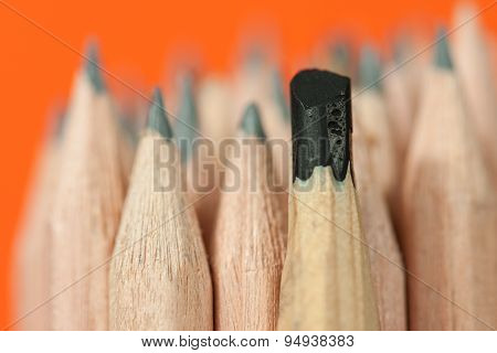Sketching pencil with thick graphite among a bunch of regular inexpensive wooden drawing pencils