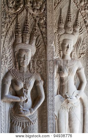 Apsara Dancers Carved In Stone, All Around On The Walls At Angkor Wat