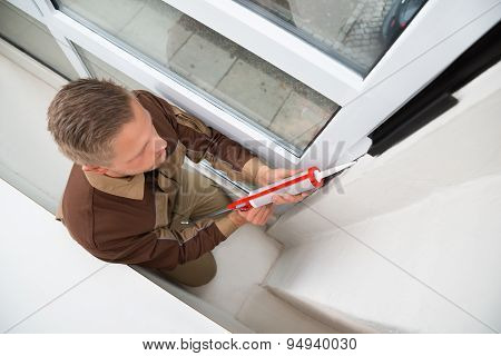 Man Applying Silicone Sealant With Gun