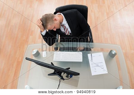 Unhappy Businessman In Office
