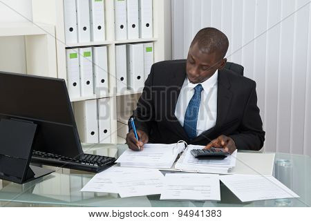 Businessman Calculating Finance Bills