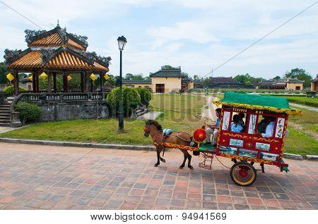 Vietnamese carriage run in Forbidden city in Hue, Vietnam.