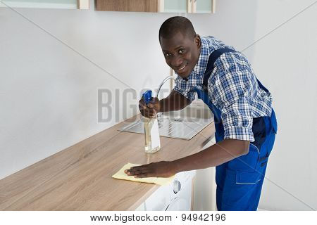 Janitor Cleaning Kitchen Worktop