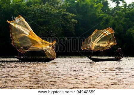 Fishermen are throwing fishing net in Hue, Vietnam