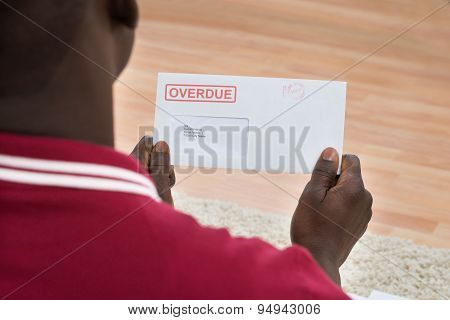 Man Holding Overdue Notice