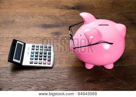 Pink Piggybank And Calculator