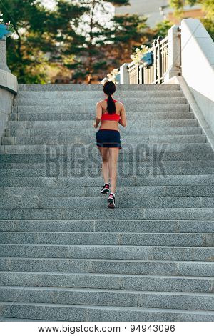 woman running on city stairs