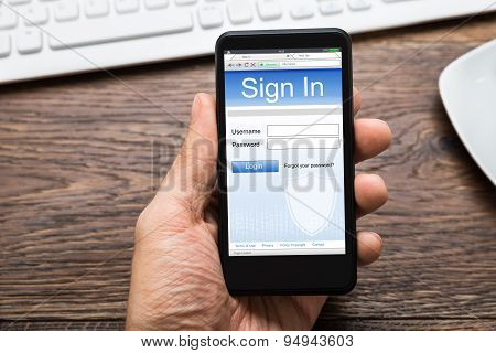 Person Hands With Mobile Phone Showing Signing Of Account