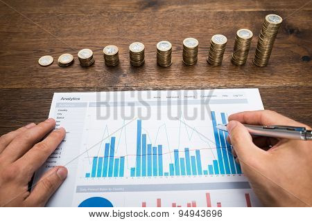 Businessman Analyzing Financial Graph