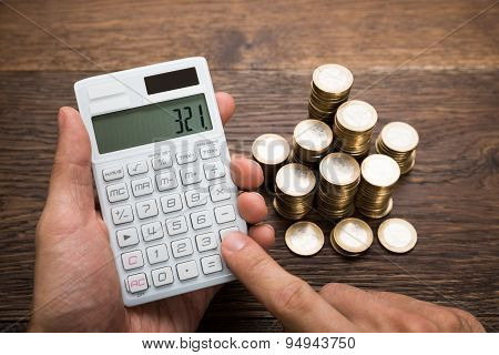 Businessman Calculating Coins
