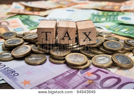 Wooden Blocks With Word Tax On Money