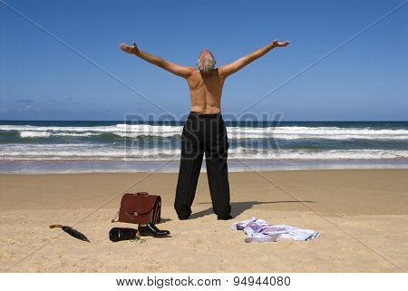 Businessman With Arms Outstretched On Tropical Caribbean Beach