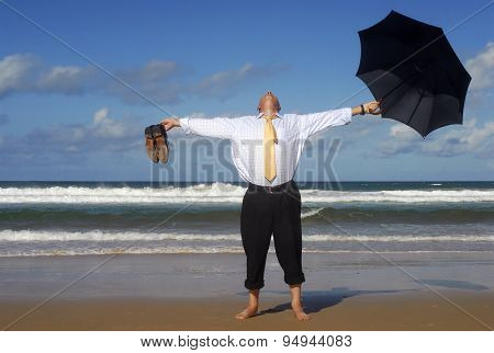 Businessman In Paradise With Umbrella And Shoes