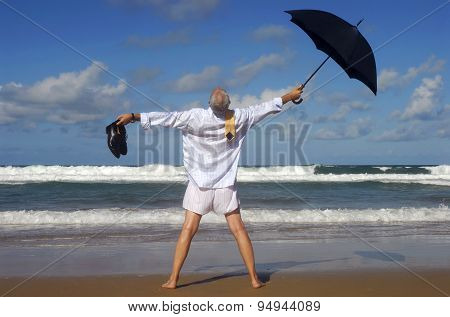 Businessman On A Tropical Beach With Umbrella And Shoes