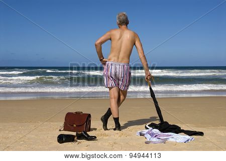 Businessman Retired And Undressed An A Tropical Caribbean Beach