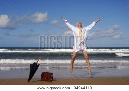 Businessman Jumping With Happiness On A Beautiful Tropical Beach
