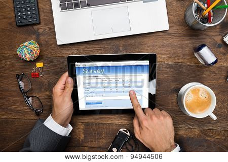 Businessman Filling Online Survey Form