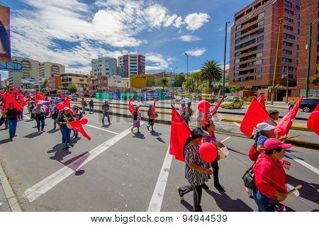 Supporters of Union Popular party participating by marching and protesting in capital Quito during c
