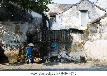 Street vendor near old wall in Hoian, Vietnam