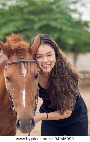 Girl With Chestnut Pony