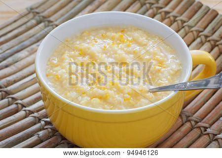 Corn Porridge In Yellow Bowl