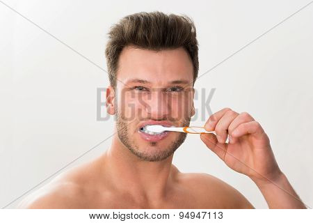 Close-up Of Man Brushing His Teeth