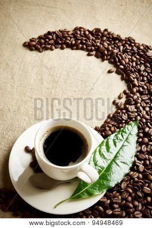 Coffee Cup With Beans Twisted In A Swirl On Flax Textile