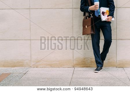 Businessman With Documents And Coffee