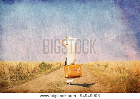 Redhead Girl With Suitcase At Countryside Road