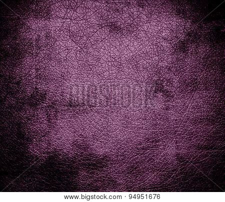 Grunge background of antique fuchsia leather texture