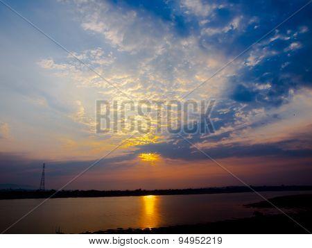 Sunrise along the Mekong River in Nakhon Phanom , Thailand .