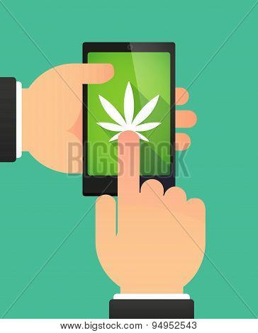 Man's Hands Using A Phone Showing A Marijuana Leaf