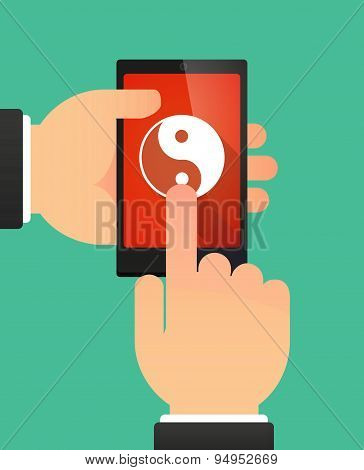 Man's Hands Using A Phone Showing A Ying Yang