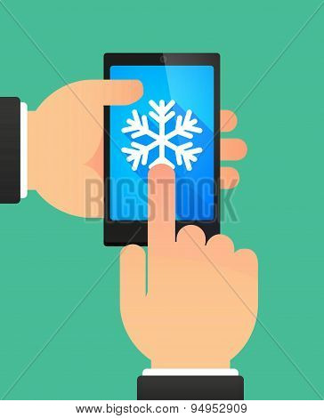 Man's Hands Using A Phone Showing A Snow Flake