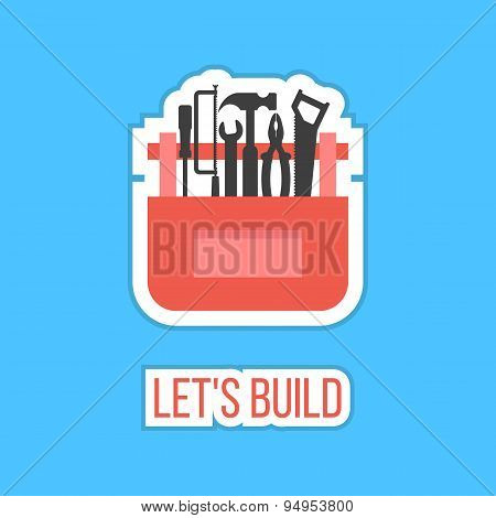 black tools in red box sticker with let's build inscription