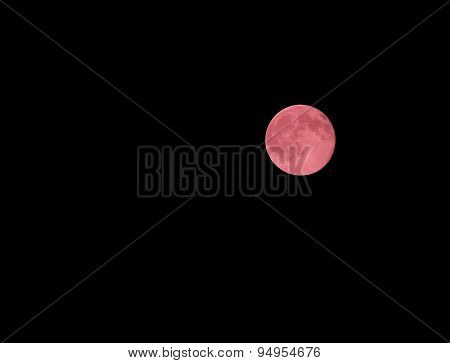 Red Moon With The Highly Visible Craters In The Night