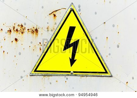 Old Yellow High Voltage Sign