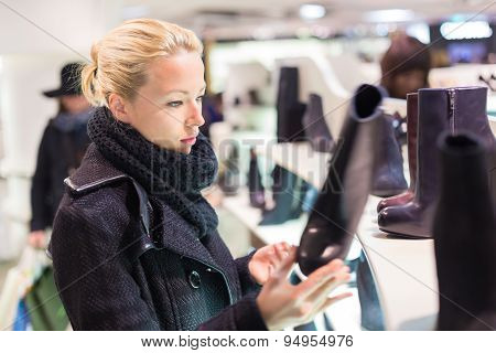 Beautiful woman shopping in shoe store.
