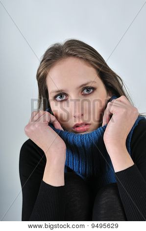 Portrait Of Young Beautiful Woman Holding Collar