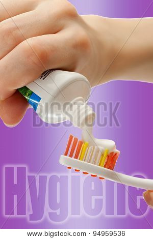 Toothbrush And Toothpaste In Female Hands