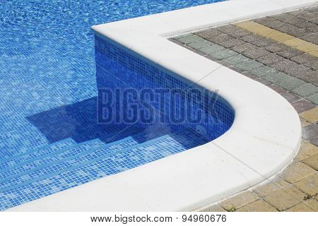 Swimming Poolside With Stairs As A Background