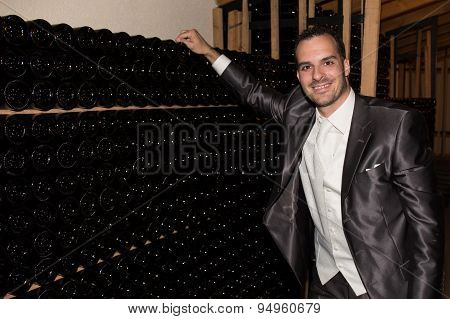Charming And Handsome Man At Cellar Wine