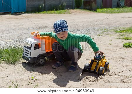 The Boy Plays With Machines On The Street