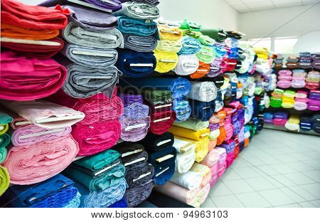 Rolls Of Fabric And Textiles In A Factpory Shop.